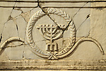Israel, Beth Shean valley, a stone from the 4th-7th centuries Synagogue of Hurvat Parva with a relief of a Menorah, on display in Kibbutz Ein Hanatziv