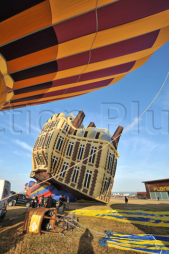 26.07.2015. Chambley Bussieres, France. Hot Air balloon presentation.  A Balloon made to reflect a building leaves the ground