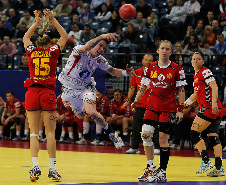 BELGRADE, SERBIA - DECEMBER 16: Anja Edin (C) of Norway jump to scores past Andrea Klikovac of Montenegro (L) during the Women's European Handball Championship 2012 gold medal match between Norway and Montenegro at Arena Hall on December 16, 2012 in Belgrade, Serbia. (Photo by Srdjan Stevanovic/Getty Images)
