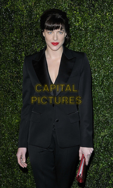 Michelle Ryan.The 58th London Evening Standard Theatre Awards in association with Burberry, Savoy Hotel, The Strand, London, England..November 25th, 2012.half length  black trousers blazer suit hand on hip red clutch bag lipstick .CAP/CAN.©Can Nguyen/Capital Pictures.