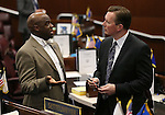 Nevada Sens. Kelvin Atkinson, D-Las Vegas, left, and Ben Kieckhefer, R-Reno, talk on the Senate floor at the Legislative Building in Carson City, Nev., on Wednesday, May 27, 2015. <br /> Photo by Cathleen Allison