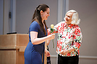 USA International Harp Competition Founder and Artistic Director Susann McDonald greets contestant Abigail Kent of the United States with a rose during the opening ceremony of the 11th USA International Harp Competition at Indiana University in Bloomington, Indiana on Wednesday, July 3, 2019. (Photo by James Brosher)