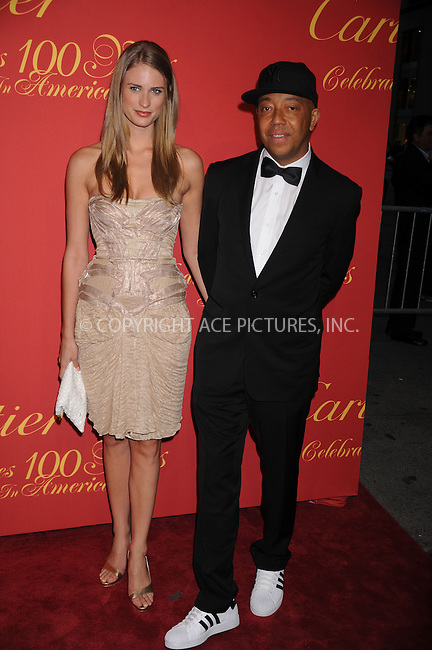 WWW.ACEPIXS.COM . . . . . ....April 30 2009, New York City....Supermodel Julie Henderson and Russell Simmons  arriving at the Cartier 100th Anniversary in America Celebration at Cartier Fifth Avenue Mansion on April 30, 2009 in New York City.....Please byline: KRISTIN CALLAHAN - ACEPIXS.COM.. . . . . . ..Ace Pictures, Inc:  ..tel: (212) 243 8787 or (646) 769 0430..e-mail: info@acepixs.com..web: http://www.acepixs.com