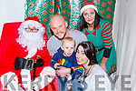 Caleb Kenny-Wade with his parents Mike and Orla met Santa Claus and his elf Danielle Lyne at the Castlemaine Christmas party on Sunday