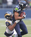 Seattle Seahawks wide receiver Doug Baldwin is dragged down from behind by St. Louis Rams safety Trumaine Johnson after catching an 12-yard pass from quarterback Russell Wilson at CenturyLink Field in Seattle, Washington on December 30, 2012.   Tate caught two passes for  19 yards in the Seahawks 20-13 come from behind win over the Rams.     © 2102.  Jim Bryant Photo. All Rights Reserved.