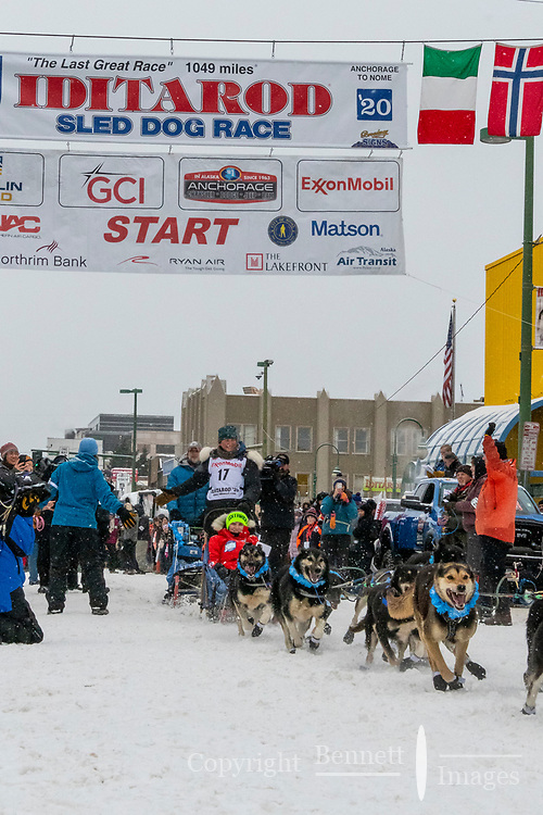 Gabe Dunham  and team leave the ceremonial start line with an Iditarider and handler at 4th Avenue and D street in downtown Anchorage, Alaska on Saturday March 7th during the 2020 Iditarod race. Photo copyright by Cathy Hart Photography.com
