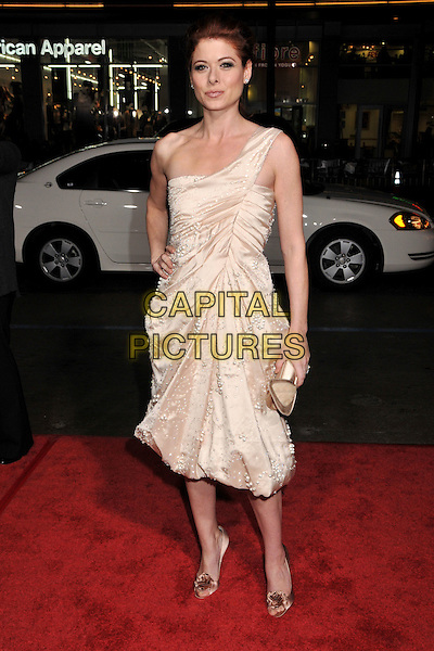 """DEBRA MESSING.""""Nothing Like the Holidays"""" Los Angeles Premiere at Grauman's Chinese Theatre, Hollywood, California, USA..December 3rd, 2008.full length dress clutch bag cream silk satin clutch bag hand on hip gold one shoulder .CAP/ADM/BP.©Byron Purvis/AdMedia/Capital Pictures."""