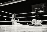 Slumped in his corner, a wrestler raises his hands in submission after being felled by his opponent during a bout at Doglegs, an event for wrestlers with physical and mental handicaps in Tokyo, Japan.