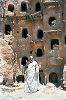 Libya     Nalut ..Berber granary with Ghorfas at Ksarr Qasr-al-Hadj Nafusah Mountains Libya .Male Berber In Traditional Dress