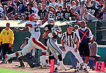 Oakland Raiders vs. Cleveland Browns at Oakland Alameda County Coliseum Sunday, September 24, 2000.  Raiders beat Browns  36-10.  Cleveland Browns defensive back Lewis Sanders (25) breaks up pass to Oakland Raiders wide receiver James Jett (82).