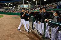 Batavia Muckdogs pitcher Eli Villalobos (21) is greeted at the dugout by Gunner Pollman, Easton Lucas, and Andrew Nardi after pitching 3.2 innings in relief during a NY-Penn League Semifinal Playoff game against the Lowell Spinners on September 4, 2019 at Dwyer Stadium in Batavia, New York.  Batavia defeated Lowell 4-1.  (Mike Janes/Four Seam Images)