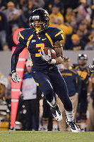 WVU wide receiver Stedman Bailey heads to the endzone on a 63-yard touchdown catch. The WVU Mountaineers beat the Pitt Panthers 21-20 at Mountaineer Field in Morgantown, West Virginia on November 25, 2011.
