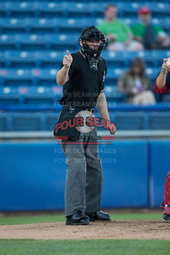 Home plate umpire Skyler Shown makes a strike call during the Carolina League game between the Winston-Salem Dash and the Salem Red Sox at LewisGale Field at Salem Memorial Ballpark on May 13, 2015 in Salem, Virginia.  The Red Sox defeated the Dash 8-2.  (Brian Westerholt/Four Seam Images)