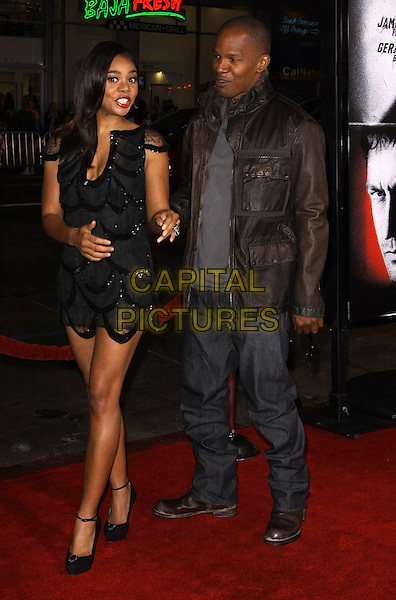 REGINA HALL & JAMIE FOXX.The Overature Film L.A. Premiere of Law Abiding Citizen held at The Grauman's Chinese Theater in Hollywood, California, USA. .October 6th, 2009 .full length jaime grey gray jeans denim leather jacket top brown black sequins sequined dress sheer .CAP/ADM/KB.©Kevan Brooks/AdMedia/Capital Pictures.