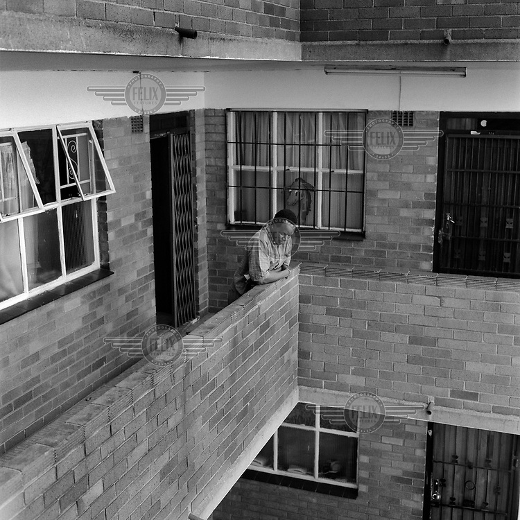 Lamek looks over a balcony in Golden Acres apartments in Berea.