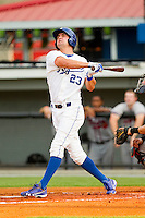 Bubba Starling (23) of the Burlington Royals follows through on his swing after hitting a solo home run against the Danville Braves at Burlington Athletic Park on July 19, 2012 in Burlington, North Carolina.  The Royals defeated the Braves 4-3.  (Brian Westerholt/Four Seam Images)