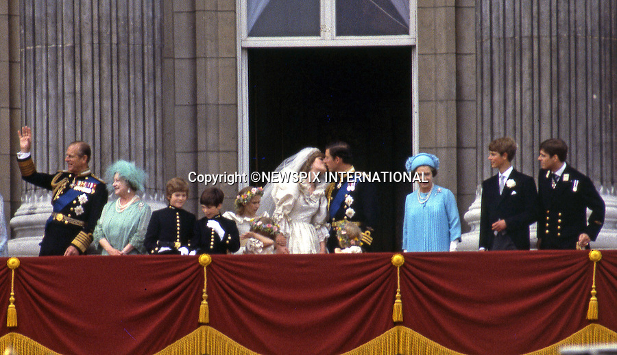 """WEDDING ROYAL KISSES_PRINCE CHARLES AND PRINCESS DIANA.a lot can read into a public kiss and body language..Prince Charles and Princess Diana Kiss on the balcony of Buckingham Palace on their wedding day, London_29/07/1981.Mandatory Photo Credit: ©Francis Dias/Newspix International..**ALL FEES PAYABLE  TO: """"NEWSPIX INTERNATIONAL""""**..PHOTO CREDIT MANDATORY!!: NEWSPIX INTERNATIONAL(Failure to credit will incur a surcharge of 100% of reproduction fees)..IMMEDIATE CONFIRMATION OF USAGE REQUIRED:.Newspix International, 31 Chinnery Hill, Bishop's Stortford, ENGLAND CM23 3PS.Tel:+441279 324672  ; Fax: +441279656877.Mobile:  0777568 1153.e-mail: info@newspixinternational.co.uk"""