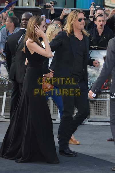 Angelina Jolie, Brad Pitt<br /> 'World War Z' world premiere, Empire cinema, Leicester Square, London, England 2nd June 2013 <br /> full length black dress suit goatee facial hair couple sunglasses shades holding hands side profile arm<br /> CAP/PL<br /> &copy;Phil Loftus/Capital Pictures