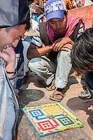 Nepal, Kathmandu.  Young Men Playing Parchesi in Durbar Square.