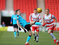 Ashley Hunter of Fleetwood Town wins the ball against Craig Alcock of Doncaster Rovers during the Sky Bet League 1 match between Doncaster Rovers and Fleetwood Town at the Keepmoat Stadium, Doncaster, England on 17 February 2018. Photo by Leila Coker / PRiME Media Images.during the Sky Bet League 1 match between Doncaster Rovers and Fleetwood Town at the Keepmoat Stadium, Doncaster, England on 17 February 2018. Photo by Leila Coker / PRiME Media Images.