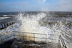 Wave swash hitting sea wall, Felixstowe, Suffolk, England