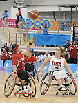 November 19 2011 - Guadalajara, Mexico:   Cindy Ouellet of Team Canada picks up a pass beside Rebecca Murray of Team USA in the Gold Medal Game in the CODE Alcalde Sports Complex at the 2011 Parapan American Games in Guadalajara, Mexico.  Photos: Matthew Murnaghan/Canadian Paralympic Committee