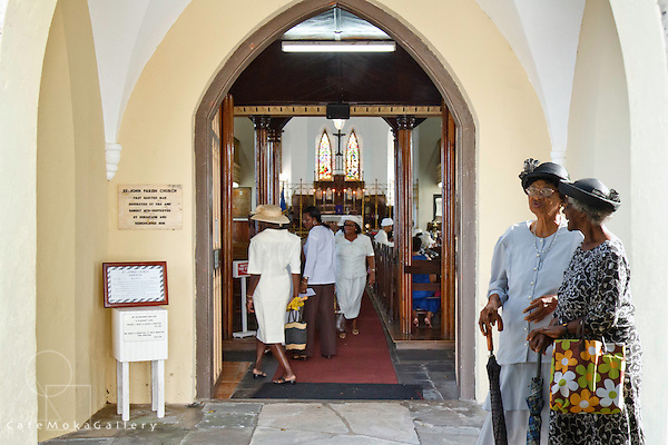 Barbados - St John's Parish Church - two elderly, smartly dressed women talking before the service at the church entrance