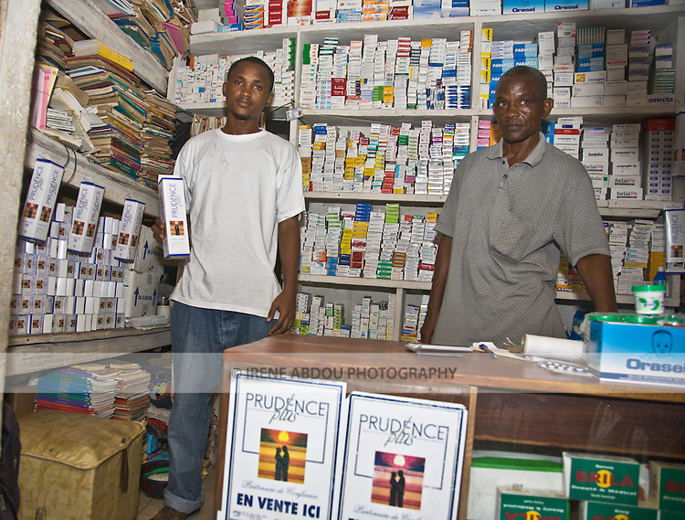 A wholesaler in Conakry, Guinea, carries packages of Prudence Plus condoms on the shelves.  Prudence Plus is distributed by the international social marketing organization, Popualtion Services International.