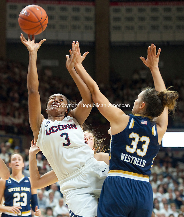 STORRS, CT--- -12015JS14--UConn's Morgan Tuck (3) puts up a shot in front of Notre Dame's Kathryn Westbeld (33) during their game Saturday at Gampel Pavilion in Storrs. <br /> Jim Shannon Republican-American