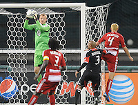 D.C. United goalkeeper Joe Willis (30) goes up to make a save.  D.C. United defeated FC Dallas 4-1 at RFK Stadium, Friday March 30, 2012.