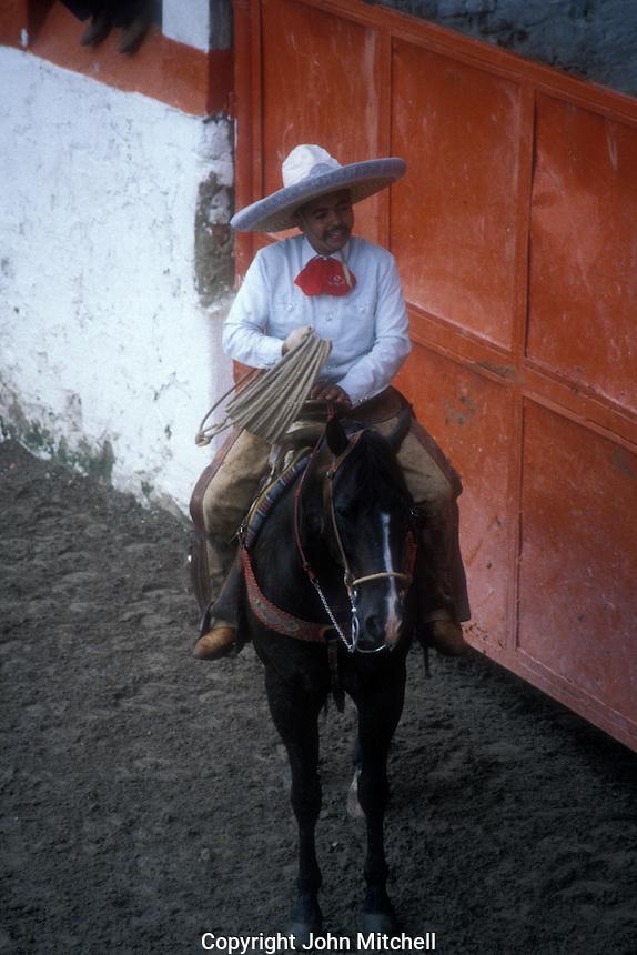 Mexican cowboy or charro on horseback at a Mexican rodeo or charreada, Guadalajara, Jalisco, Mexico