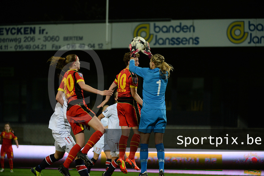 20140410 - LEUVEN , BELGIUM : Norway goalkeeper Ingrid Hjelmseth pictured in an aerial duel with Belgian Aline Zeler (10)  during the female soccer match between Belgium and Norway, on the seventh matchday in group 5 of the UEFA qualifying round to the FIFA Women World Cup in Canada 2015 at Stadion Den Dreef , Leuven . Thursday 10th April 2014 . PHOTO DAVID CATRY