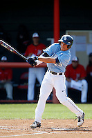 A. J. Robinson #25 of the University of San Diego Toreros bats against the Cal State Northridge Matadors at Matador Field on March 26, 2013 in Northridge, California. (Larry Goren/Four Seam Images)