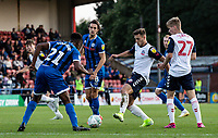 Bolton Wanderers' Dennis Politic (centre) competing with Rochdale's Tyler Magloire<br /> <br /> Photographer Andrew Kearns/CameraSport<br /> <br /> The Carabao Cup First Round - Rochdale v Bolton Wanderers - Tuesday 13th August 2019 - Spotland Stadium - Rochdale<br />  <br /> World Copyright © 2019 CameraSport. All rights reserved. 43 Linden Ave. Countesthorpe. Leicester. England. LE8 5PG - Tel: +44 (0) 116 277 4147 - admin@camerasport.com - www.camerasport.com