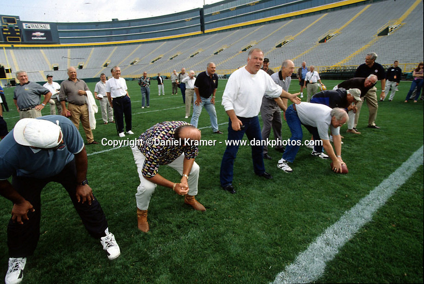 During a re-enactment of the final play of the Ice Bowl in September of 2001, former Packer guard Jerry Kramer points out that he was not offsides but that center Kenny Bowman hiked the ball late.