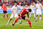 Hwang Uijo of South Korea (R) competes for the ball with Shi Ke of China (L) during the AFC Asian Cup UAE 2019 Group C match between South Korea (KOR) and China (CHN)  at Al Nahyan Stadium on 16 January 2019 in Abu Dhabi, United Arab Emirates. Photo by Marcio Rodrigo Machado / Power Sport Images