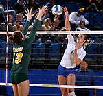 BROOKINGS, SD - SEPTEMBER 30:  Emily Veldman #12 from South Dakota State tries to get a kill past Jenni Fassbender #13 from North Dakota State in the third game of their match Tuesday night at Frost Arena in Brookings. (Photo/Dave Eggen/Inertia)