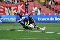 BOGOTA - COLOMBIA - 23-08-2015: Armando Vargas (Fuera de Cuadro), jugador de Independiente Santa Fe anota gol a Jhonny da Silva, portero de Atletico Huila, durante partido por la fecha 5 entre Independiente Santa Fe y Aguilas Doradas de la Liga Aguila II-2015, en el estadio Nemesio Camacho El Campin de la ciudad de Bogota. / Armando Vargas (Out of Pic), player of Independiente Santa Fe scored a goal to Jhonny da Silva, goalkeeper of Atletico Huila during a match of the 8 date between Independiente Santa Fe and Atletico Huila, for the Liga Aguila II -2015 at the Nemesio Camacho El Campin Stadium in Bogota city, Photo: VizzorImage / Luis Ramirez / Staff.