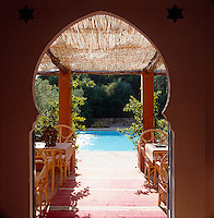 The architecture of Marrakech was the inspiration behind the design of this Spanish poolhouse