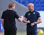 Trainer Markus Gisdol (1. FC Koeln) und Trainer Alfred Schreuder (Hoffenheim) schlagen mit dem Ellenbogen ab.<br /> <br /> Sport: Fussball: 1. Bundesliga: Saison 19/20: 28. Spieltag: TSG 1899 Hoffenheim - 1. FC Koeln, 27.05.2020<br /> <br /> Foto: Markus Gilliar/GES/POOL/PIX-Sportfotos.<br /> <br /> Nur für journalistische Zwecke! Only for editorial use!<br /> <br /> Gemäß den Vorgaben der DFL Deutsche Fußball Liga ist es untersagt, in dem Stadion und/oder vom Spiel angefertigte Fotoaufnahmen in Form von Sequenzbildern und/oder videoähnlichen Fotostrecken zu verwerten bzw. verwerten zu lassen. DFL regulations prohibit any use of photographs as image sequences and/or quasi-video.