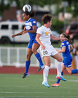 In a National Women's Soccer League Elite (NWSL) match, the Boston Breakers defeated the Western New York Flash  2-1, at Dilboy Stadium on May 5, 2013.  Boston Breakers defender Kia McNeill (14) and Western New York Flash forward Abby Wambach (20) leap for a head ball.