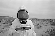 """April 18-24, 1979, Nevada, USA --- For the first time American soldiers from different regiments have worked together on the test """"Nuwax 79"""", a simulation of a nuclear accident. The test took place in the Nevada Desert, 150 kilometers from Las Vegas. The exercise consisted of a crashed aeroplane loaded with nuclear weapons, of plutonium 239, and the response time of emergency services to the contaminated areas. With an eye for realism radium 233 was used, which has limited radioactivity and which has been used for a similar exercise in Great Britain. --- Image by © JP Laffont/Sygma/Corbis"""