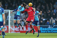 Joe Jacobson of Wycombe Wanderers (3) and Paul McCallum of Leyton Orient (10) battle for the ball during the Sky Bet League 2 match between Wycombe Wanderers and Leyton Orient at Adams Park, High Wycombe, England on 17 December 2016. Photo by David Horn / PRiME Media Images.