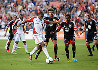 Dejan Jakovic (5) of D.C. United tries to keep Reggie Lambe (19) of Toronto FC in front of him during a game at RFK Stadium in Washington, DC.  D.C. United tied Toronto FC, 1-1.