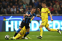 Football Soccer: UEFA Champions League -Group Stage- Group F Internazionale Milano vs Borussia Dortmund, Giuseppe Meazza stadium, October 23, 2019.<br /> Inter's Sebastiano Esposito (c) in action with Borussia Dortmund's captain Mats Hummels (l) and Julian Weigl  (r) during the Uefa Champions League football match between Internazionale Milano and Borussia Dortmund at Giuseppe Meazza (San Siro) stadium, on October 23, 2019.<br /> UPDATE IMAGES PRESS/Isabella Bonotto