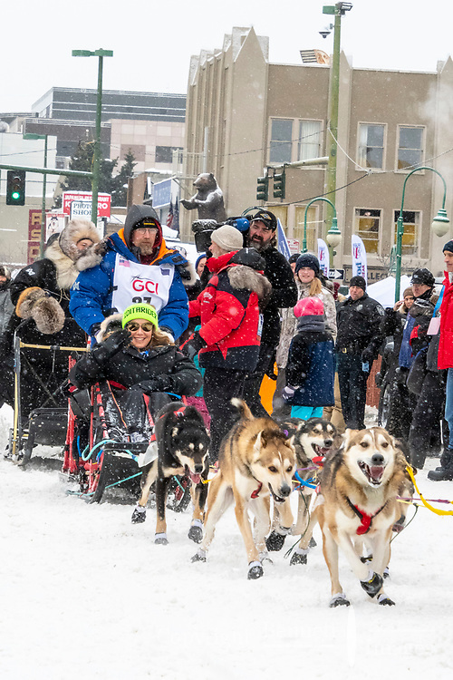 Mitch Seavey  and team leave the ceremonial start line with an Iditarider and handler at 4th Avenue and D street in downtown Anchorage, Alaska on Saturday March 7th during the 2020 Iditarod race. Photo copyright by Cathy Hart Photography.com