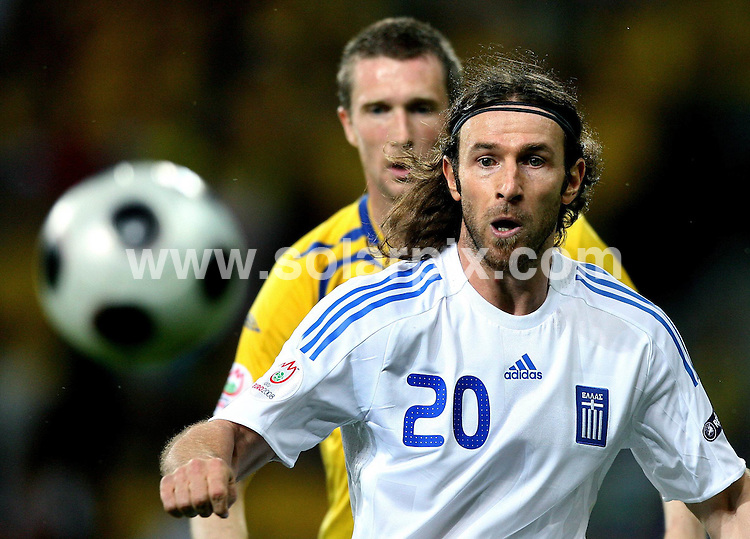 **ALL ROUND PICTURES FROM SOLARPIX.COM**.**SYNDICATION RIGHTS FOR UK AND SPAIN ONLY**.European Championship tournament Euro 2008, Greece versus Sweden at the Wals-Siezenheim Stadium, Salzburg, Austria. Sweden 2 Greece 0. 10th June 2008..This pic: Giourkas Seitaridis against Mikael Nilsson..JOB REF: 6606 CPR/Ronny Hartmann       .DATE: 10_06_2008.**MUST CREDIT SOLARPIX.COM OR DOUBLE FEE WILL BE CHARGED* *UNDER NO CIRCUMSTANCES IS THIS IMAGE TO BE REPRODUCED FOR ANY ONLINE EDITION WITHOUT PRIOR PERMISSION*