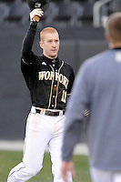 Shortstop Derek Hirsch (11) of the Wofford College Terriers is congratulated after scoring a run in a game against the Boston College Eagles on Friday, February 13, 2015, at Russell C. King Field in Spartanburg, South Carolina. Wofford won, 8-4. (Tom Priddy/Four Seam Images)