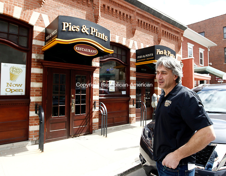 Waterbury, CT- 05 April 2014-040514CM01- Theo Anastasiadis, one of the partners at Pies and Pints Restaurant talks about the new signs outside their place in Waterbury on Saturday.  Anastasiadis and Christos Gogas opened up the new establishment inside the former Drescher's on Leavenworth St.  Christopher Massa Republican-American