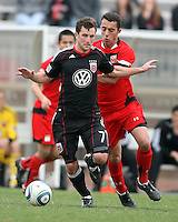 Stephen King (7) of D.C. United tackled by Paul Torres (6)  during a scrimmage against the University of Maryland at Ludwig Field, University of Maryland, College Park, on April  10 2011. D.C. United won 1-0.